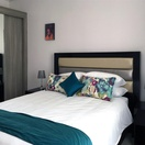 Apartments @ 125 - 2 bedroom unit; main bedroom including queen size bed
