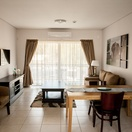 Apartments @ 125 - 1 bedroom unit; lounge & dining area including smart enabled TV