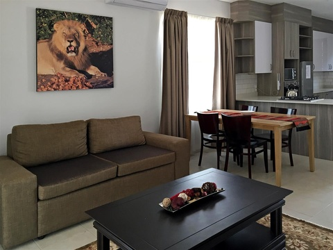 Apartments @ 125 - 2 bedroom unit; lounge & dining area, equipped with smart enabled TV