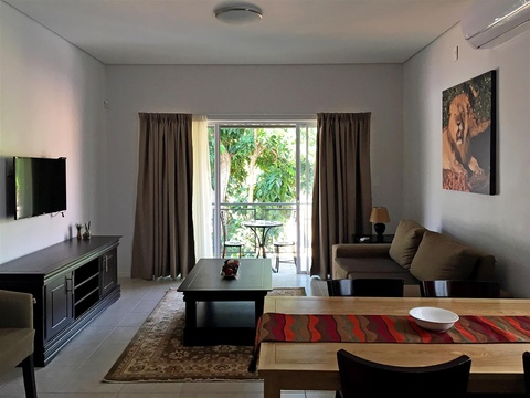 Apartments @ 125 - 2 bedroom unit; dining & lounge area, looking onto the balcony