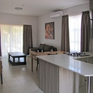 Apartments @ 125 - 2 bedroom unit; dining area, lounge including smart enabled TV