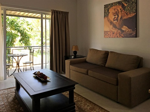 Apartments @ 125 - 2 bedroom unit; lounge & balcony area